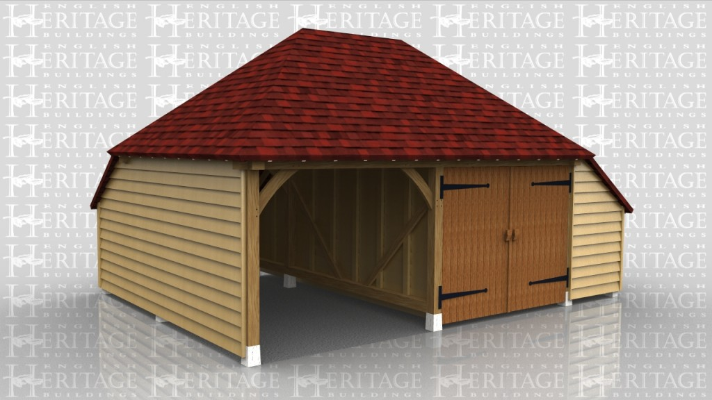Two bay oak framed garage with central partition and garage doors to one side. This building sits on staddle stones on top of concrete pad foundations so there is no bickwork or oversite required.