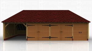 Four bay oak framed building with one open garage bay, 2 secure garage bays with garage doors and a store area with double doors on the front.