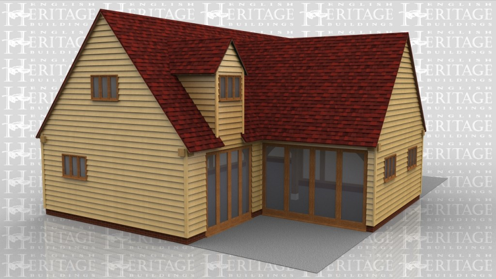 This oak framed house was designed for a customer in Hampshire and is formed of two different frames. The first frame is a large five bay building with two dormers to the front, each with a three pane window. To the front of the building one bay has full length garden room windows, and another bay has a set back front wall with a single solid door. The second frame is a one bay building, attached at the left hand end, with a gable roof end. The rear is fully glazed with full length windows. There is trimming for two rooflights at the rear to add more natural light.