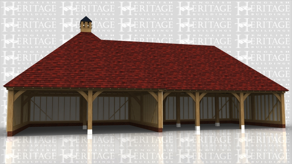 This building comprises of two frames. The first is a large square frame with hipped roof and a dovecote at the top. The second frame attached to it comprises of 3 open bays, 2 for cars and the other slightly smaller for garden machinery or motorbikes.