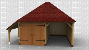This two bay oak framed garage has one enclosed bay and one open bay. The enclosed bay is accessed via a set of garage doors to the front of the building. There is also an open logstore to the left of the building.
