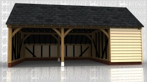 This oak framed garage has three bays; two are open and one is enclosed.The enclosed bay is accessed via a single door to the right hand side, and has a two pane window. There is an enclosed logstore to the rear of the building, which becomes an open logstore at the end bay.