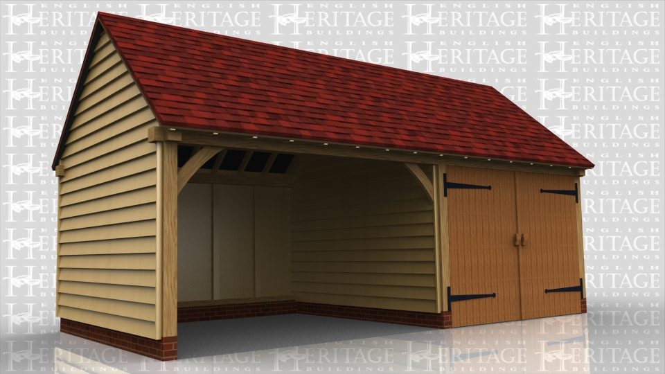 This oak framed garage building has two bays; one bay is open and one is enclosed. The enclosed bay is accessed via a set of garage doors to the front of the building.
