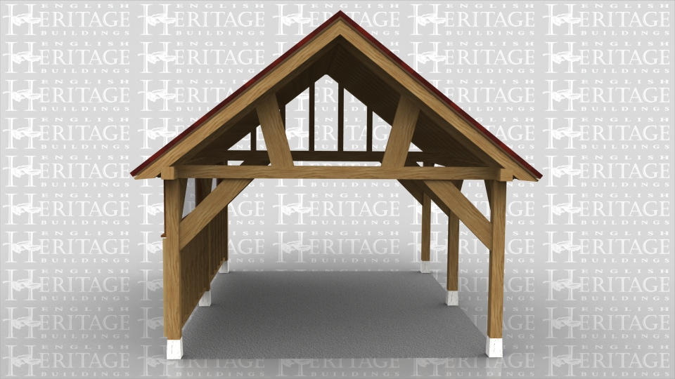 This oak framed car port has two bays, with one enclosed side to the front and the other sides open. The front side has two small windows and softwood weatherboarding.