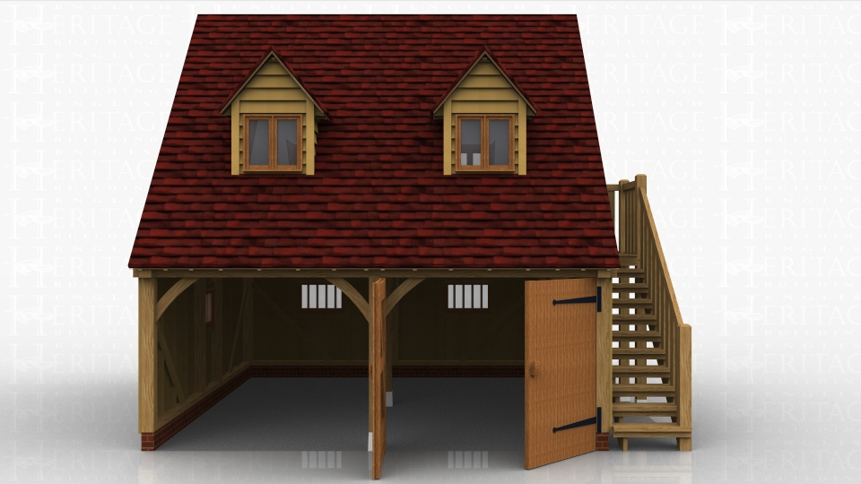 This is a two bay oak framed garage with room above. The ground floor has 2 garage bays, one open fronted and the other enclosed by a partition and a pair of garage doors. There are 3 mullion windows in the garage areas. There is an external oak staircase leading to a half glazed single door which accesses the first floor. There are 4 dormer windows suitable for two pane casement windows and a 3 pane escape casement window in the gable end.