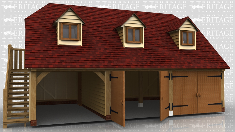 This oak framed two storey garage has three bays, two enclosed and one open. The enclosed bays have a set of garage doors to the front. The first floor is accessed by an external oak staircase on the left hand side and a single solid door. The building has three dormers to the front; each with a two pane window.