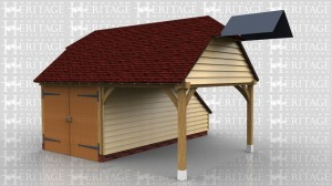 This oak framed garage is formed of two bays, one enclosed and one open. The enclosed bay is accessed by a set of garage doors to the front and has an enclosed store to the rear. The other bay is open on all sides and has a barn hip roof ending.