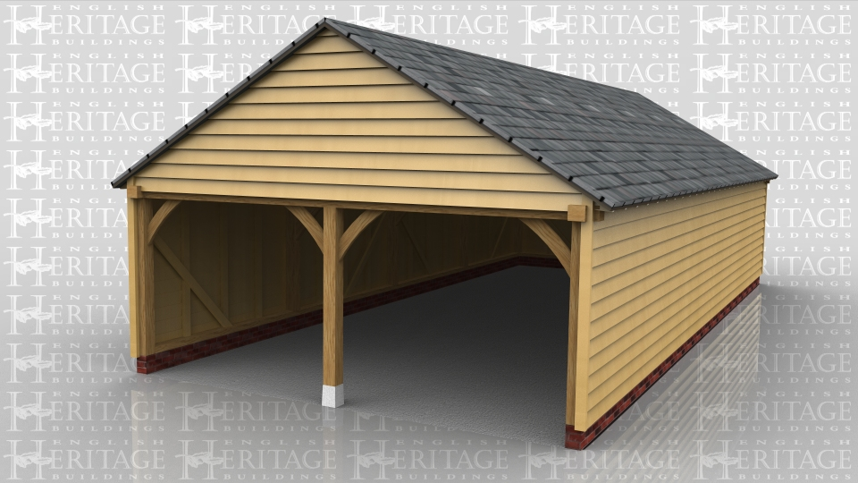This oak framed garage has two enclosed bays. The bays are accessed via the right side of the building which is left open.