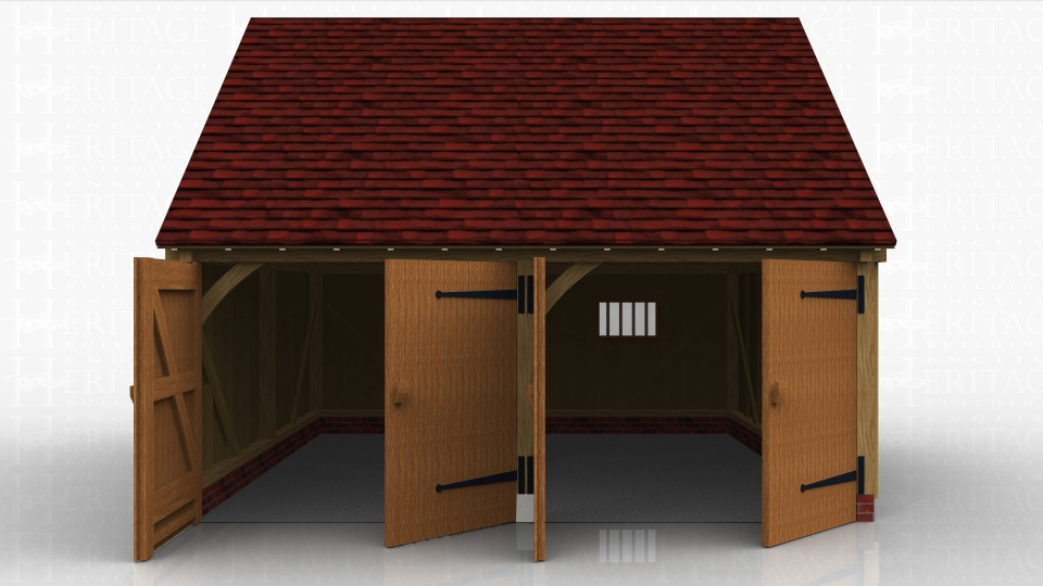 This oak framed garage has two bays, both enclosed. The bays are accessed by two sets of garage doors to the front of the building and the right hand bay has a mullion window to the rear.