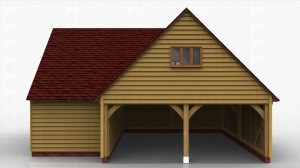 This oak framed garage is formed of two different frames. One is a two bay, two storey garage. Both bays are enclosed to the front and accessed by the left side of the building which is left open. Access to the first floor is provided by a hatch, and there is a three pane window to the left and right sides of the building. There is a smaller two bay building attached to the rear, designed to be used as a store or workshop and accessed by a single door to the front.