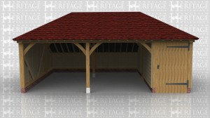 This oak framed garage is formed of three bays, two open and one smaller enclosed bay. The enclosed bay is accessed by a single door to the front, and the garage has an enclosed store to the rear.