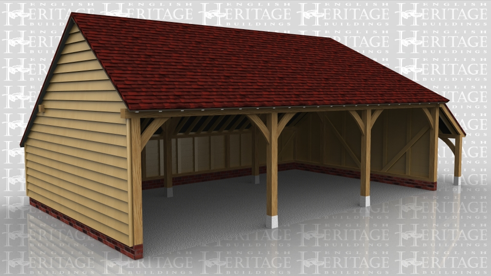 This 3 bay garage has a gable end on the left and a full hip and catslide roof over a logstore on the right. There is also a rear catslide to keep the ridge height below 4m but still maximise the internal floor area.