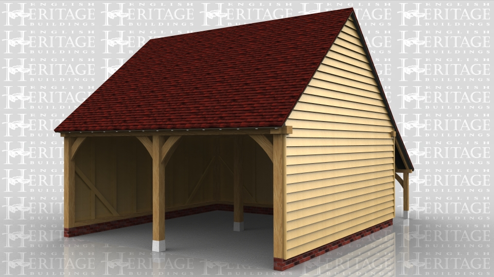 A two bay open fronted garage with gable ends and a log store at the rear.
