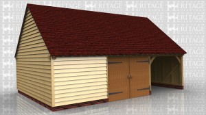 This oak framed three bay garage has one open car bay and two enclosed bays. One bay is accessed by garage doors and the other is designed to be used as a workshop or for storage.
