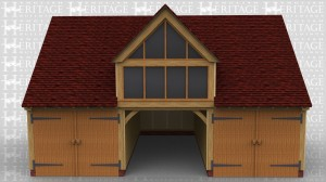 A three bay garage with the end bays secured with garage doors and front to rear partitions. The first floor is accessed through a half glazed single door in the right hand end. This is easily accessed as the building is built close to a 2m high retaining wall and the house is on the higher area. There is a full bay dormer which is fully glazed to take advantage of the magnificent views from this location.