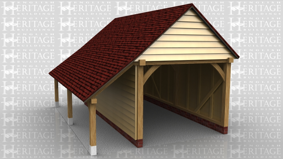 A single bay garage with gable ends and a log store to the left hand side.