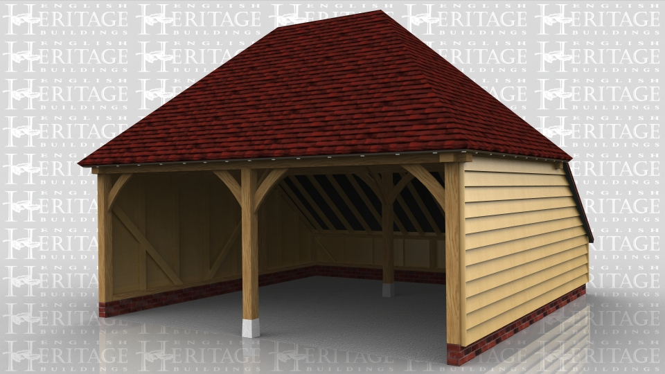 A 2 bay open fronted garage with hipped ends and a catslide roof to the rear.