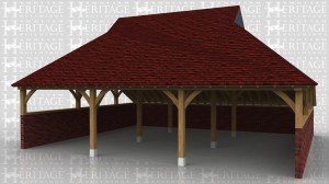 This oak framed garage sits on retaining walls on three side which are cut into a bank. The sides above the walls are left open so you just see the curved knee braces. The roof has a gablet at each end which is finished with lead sheet.