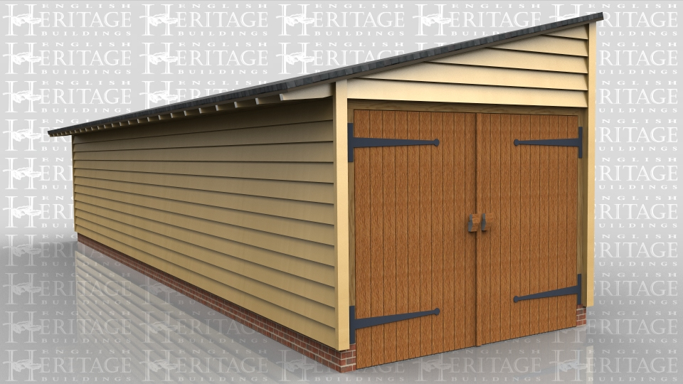 This is a long one bay monopitch garage with garage doors at one end. All other walls are clad in softwood weatherboard and the roof has a slate finish.