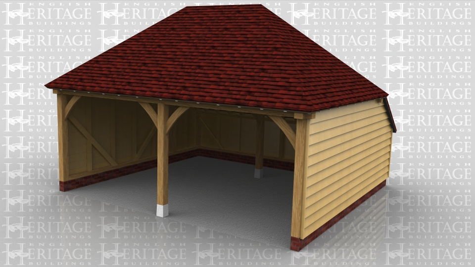 This is an open fronted two bay garage with hipped ends and a rear catslide to keep the ridge height to below 4m and maximise the internal floor area.