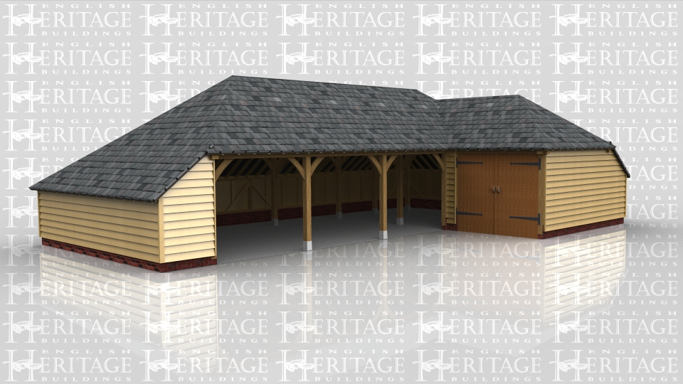 This 'L' shaped complex comprises of 3 open fronted garage bays, one bay with garage doors on the front and a workshop / store in the corner section. It has hipped roof ends with a catslide one end and a slate roof covering.