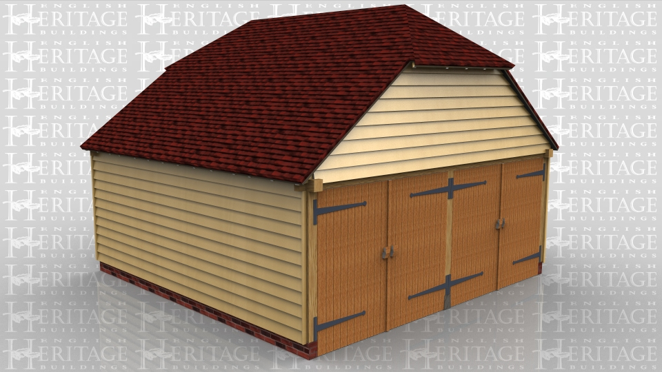 This building is a 2 bay garage secured with two pairs of traditional side hung garage doors. The roof has barn hip ends and 2 Velux rooflights.