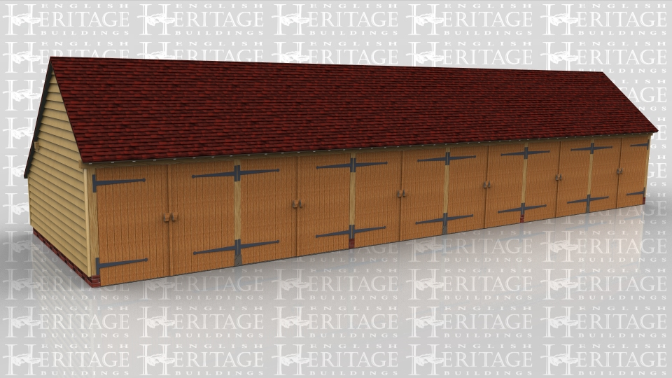 This oak framed six bay garage block is for the use of three different properties and they each have two garages each. The building has gable ends and a rear catslide to keep the ridge below 4m but still give a usable depth of garage inside. Each garage is secured at the front with a pair of traditional side hung garage doors.
