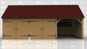 This is a three bay garage with gable ends and a rear catslide roof. Two bays are secured with 2 pairs of garage doors and a prtition which leaves the other bay open at the front.