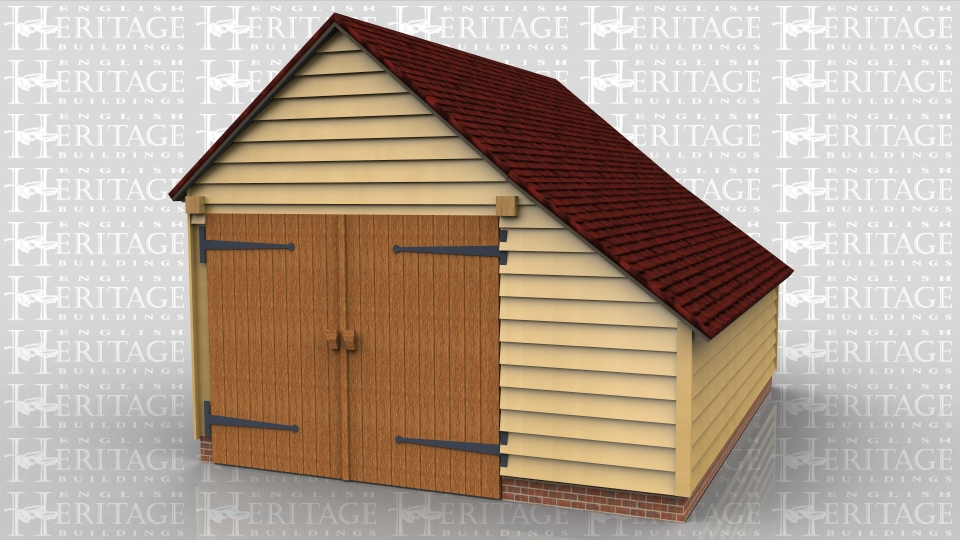 This is an enclosed one bay garage with an enclosed catslide on the right hand side. There is a pair of garage doors on the front.