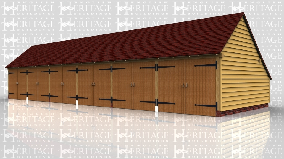 This oak framed garage building is formed of six bays, all are enclosed and accessed via garage doors to the front. There is an enclosed logstore to the rear of the building.