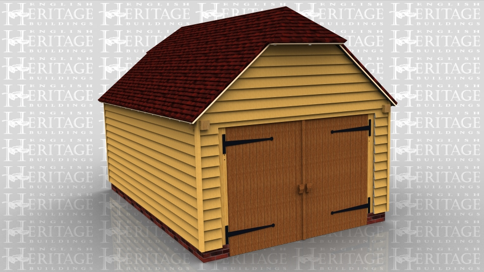 This oak frame garage is formed of two enclosed bays and there is a set of garage doors to the right side.