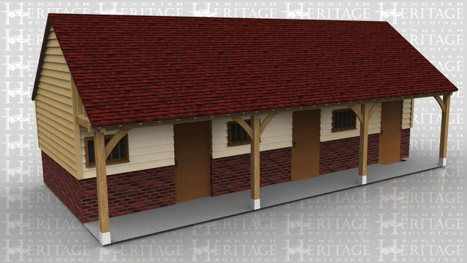 This three bay oak framed building has a set back front and is sitting on a high plinth wall. Each bay is seperated by partitions and has a decorative stable door and mullion window in the front. The centre bay also has a solid single door in the rear. Although this was made to look like a stable it is in fact three small workshop areas.
