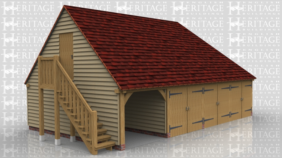 This oak framed garage with first floor has one open fronted parking space and three enclosed spaces that have garage doors on the front. There is an external oak staircase leading to a solid single door which accesses the first floor. The upstairs is one open space and there are three rooflights on the rear elevation, one of which is a means of escape.