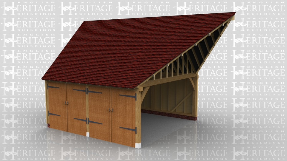 This is a two bay oak framed garage that is attached to the side of the house. The roof connects to the existing with a roof conection kit on lay boards. The oak garage is secured with two pairs of garage doors to the front.