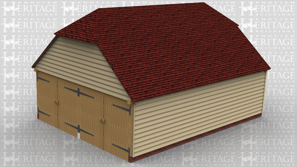 This oak framed garage is formed of three enclosed bays. Access is via two sets of garage doors to the left hand end and there are two barn hip roof endings.