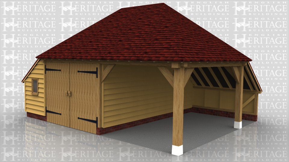 This is a two bay oak framed garage with hipped roof and enclosed storess to rear and one side. One bay is enclosed with a partition and pair of garage doors and the other bay is open to the front and side.