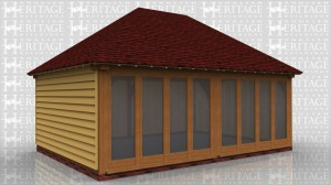This oak framed building is a two bay garden room/home office. It is a full span with hipped ends and is fully glazed on one side with opening glazed units. There is also a solid single door at the rear.