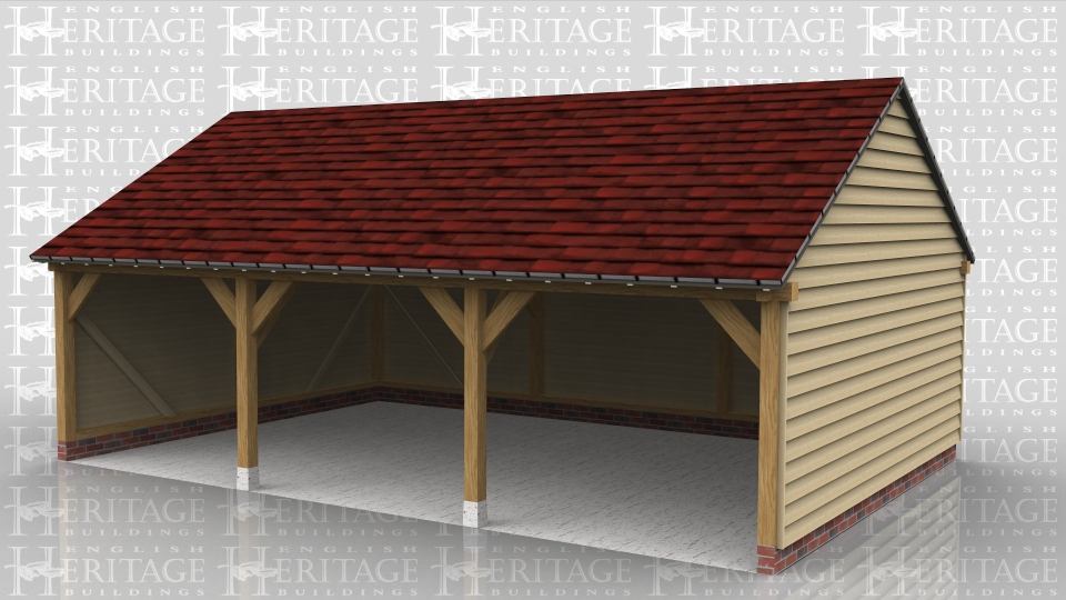 This three bay oak framed garage is open fronted and has gable ends with a low roof pitch.