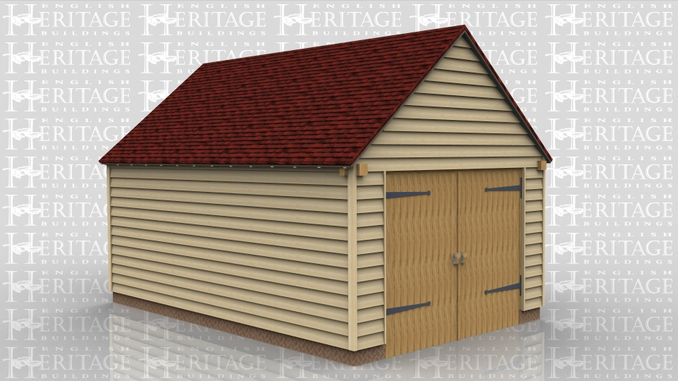 This oak framed garage has two bays that are enclosed to the front and accessed via a set of garage doors to the right side.