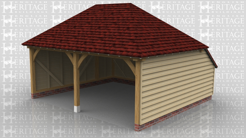 This two bay open fronted oak frame garage has hipped roof ends and an enclosed rear logstore to keep the ridge height below 4m and still give a usable internal depth.