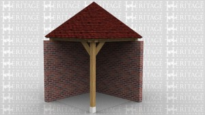 This oak frame is a small gazebo that is sitting on two existing walls.