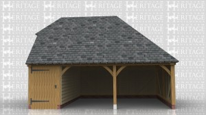 This oak framed building has two open fronted garage bays and a smaller bay enclosed with a partition and wide solid door at the front, to be used for storage. It has a barn hip on the left and a full hip on the right.