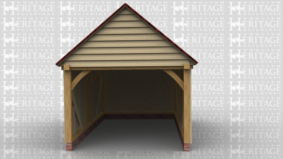 This oak framed garage has two bays that are enclosed to the front and accessed via an open left side.
