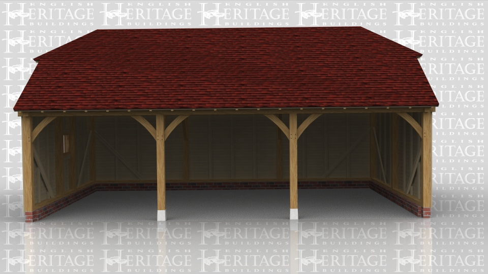 This oak framed building is a full depth three bay open fronted garage with barn hip roof ends. There is also a mullion window in the left hand side.