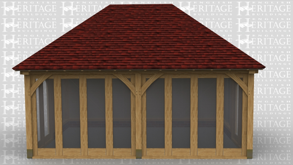 This oak framed garden room has full length windows along the front of the building and softwood boarding around the rest of the oak frame.