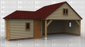 This oak framed garage complex has an enclosed storage room or workshop, a two bay open garage, and an enclosed single bay garage to the rear. The store room is accessed by two solid single doors and it has a single pane window to the front.