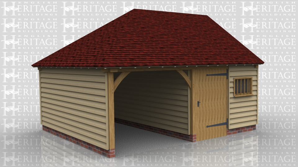 This oak framed two bay garage has one bay with an open entrance and one enclosed bay. The enclosed bay is designed to be used as a workshop or storage area and is accessed by a single door at the front.