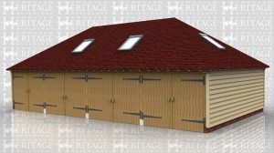 This is an oak framed garage has four enclosed bays. Each bay is secured with garage doors, and there are trimmings for six rooflights; one on the left and right sides, two at the front and two at the rear. To the rear of the middle bays there is also an enclosed store.