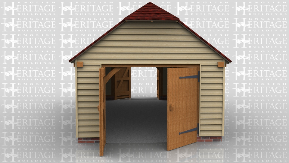 This single oak framed garage is formed of three enclosed bays. Access is via a set of garage doors to the left and right ends of the building. There is a two pane window to the front of the building and one rooflight.