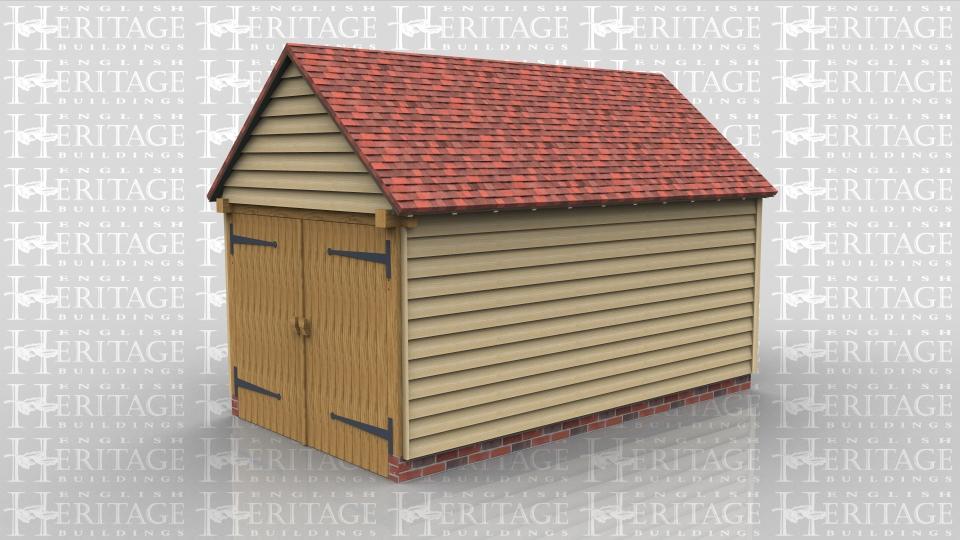 Oak framed single bay garage with garage doors.